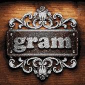 Gram vector metal word on wood — Stock Vector