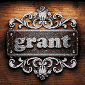 Grant vector metal word on wood — Stock Vector