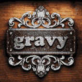 Gravy vector metal word on wood — Stock Vector
