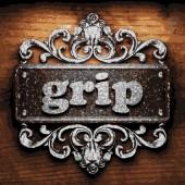 Grip vector metal word on wood — Stock Vector