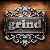 Grind vector metal word on wood — Stock Vector