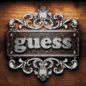 Guess vector metal word on wood — 图库矢量图片