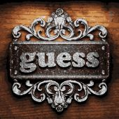 Guess vector metal word on wood — Stock Vector