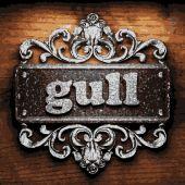 Gull vector metal word on wood — Stock Vector