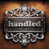 Handled vector metal word on wood — Stock Vector