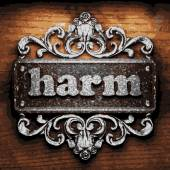 Harm vector metal word on wood — Stock Vector