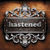 Hastened vector metal word on wood — Stock Vector