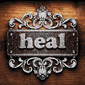 Heal vector metal word on wood — Stock Vector