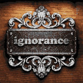 Ignorance vector metal word on wood — Stock Vector