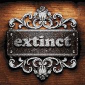 Extinct vector metal word on wood — Stock Vector