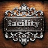 Facility vector metal word on wood — Stock Vector