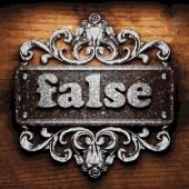 False vector metal word on wood — Stock Vector