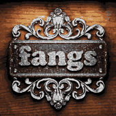Fangs vector metal word on wood — Stock Vector