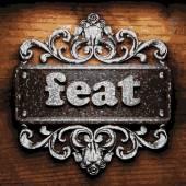 Feat vector metal word on wood — Stock Vector
