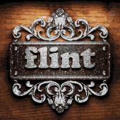 Flint vector metal word on wood — Stock Vector