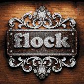 Flock vector metal word on wood — Stock Vector
