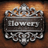 Flowery vector metal word on wood — Vector de stock