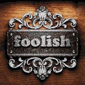 Foolish vector metal word on wood — Stock Vector