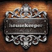 Housekeeper vector metal word on wood — Stock Vector