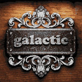 Galactic vector metal word on wood — Vector de stock