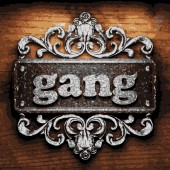 Gang vector metal word on wood — Stock Vector