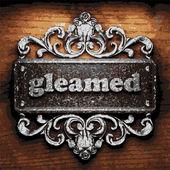 Gleamed vector metal word on wood — Stock Vector