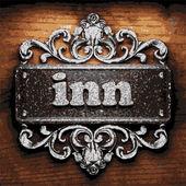 Inn vector metal word on wood — Stock Vector