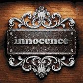 Innocence vector metal word on wood — Stock Vector