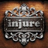 Injure vector metal word on wood — Stock Vector