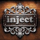 Inject vector metal word on wood — Stock Vector