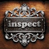 Inspect vector metal word on wood — Stock Vector