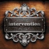 Intervention vector metal word on wood — Stock Vector