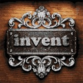 Invent vector metal word on wood — Stock Vector