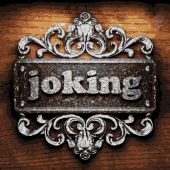 Joking vector metal word on wood — Stock Vector