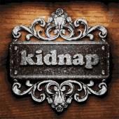 Kidnap vector metal word on wood — Stock Vector