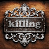 Killing vector metal word on wood — Wektor stockowy