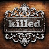 Killed vector metal word on wood — Stock Vector