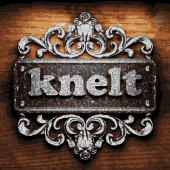 Knelt vector metal word on wood — Stock Vector