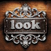 Look vector metal word on wood — Stock Vector