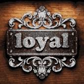 Loyal vector metal word on wood — Stock Vector