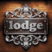 Lodge vector metal word on wood — Stock Vector