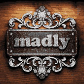 Madly vector metal word on wood — Stock Vector