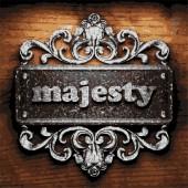 Majesty vector metal word on wood — Stock Vector