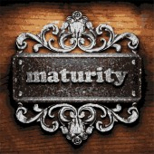 Maturity vector metal word on wood — Stock Vector