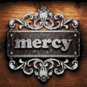 Mercy vector metal word on wood — Stock Vector