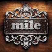 Mile vector metal word on wood — Stock Vector