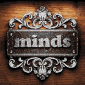 Minds vector metal word on wood — Stock Vector
