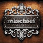 Mischief vector metal word on wood — Stock Vector