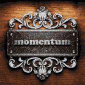 Momentum vector metal word on wood — Stock Vector