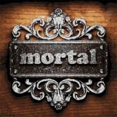 Mortal vector metal word on wood — Stock Vector